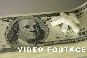 Money and drugs. Close-up, slider shot