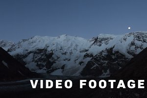 Mountains moon and sunrise - Elbrus area. Time-lapse