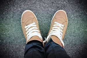 Feet with brown urban shoes