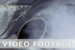 Car pipe puffs out exhaust gas