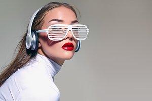 white glasses. White headphones.