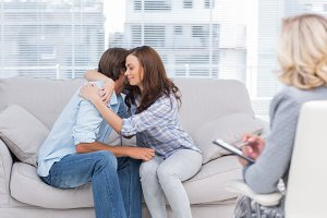 Couple reaching break through in therapy session