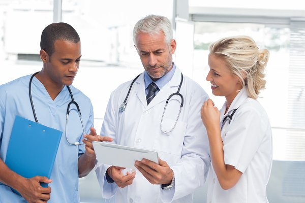 Doctors using a tablet