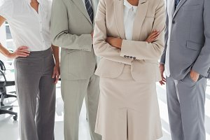 Attractive businesswoman standing in front of colleagues
