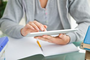 Close up of a student using a touch pad