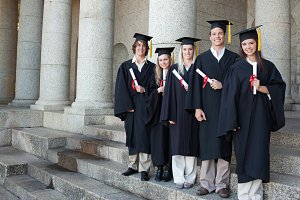 Five happy graduates posing