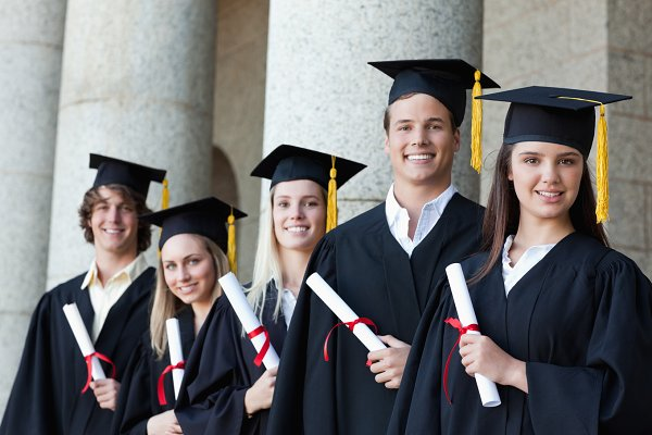 Portrait of graduates posing in sin…