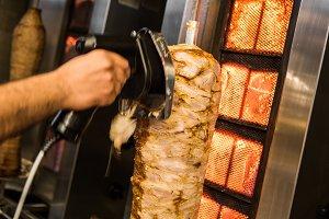 Cutting kebab meat