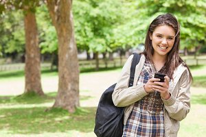 Portrait of a young student using a smartphone