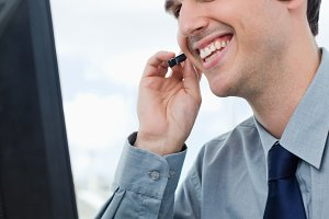 Portrait of a smiling office worker using a headset