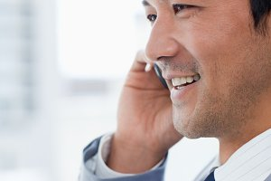 Portrait of a smiling office worker on the phone