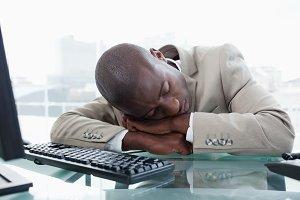 Businessman sleeping on his desk