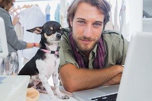 Fashion designer with his chihuahua