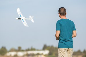 Man with remote control plane