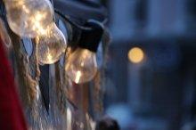 Holidays background. Blurred photo. Retro antique hanging light bulbs.