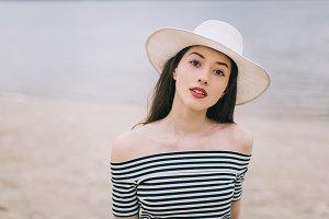 Stylish girl in white hat.