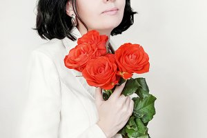 brunette woman with bouquet