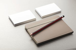 Pencil, business card and notepad on gray background. Business.
