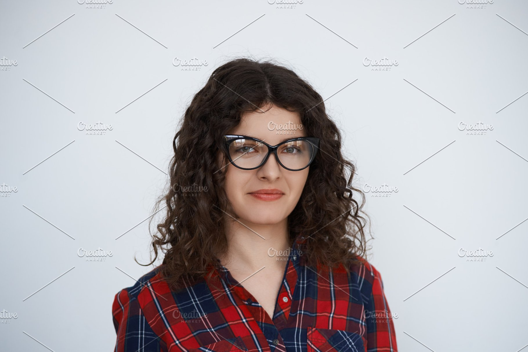 0207a0d1a62 Save. Young attractive smiling Curly hair programmer woman in trendy glasses  ...