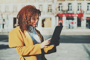Curly woman with digital pad