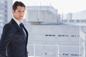 Handsome confident businessman standing