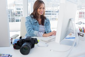 Photo editor working on computer