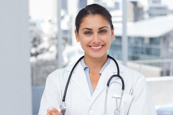 Smiling doctor standing