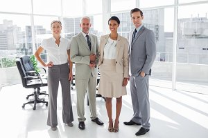 Smiling business people standing in line