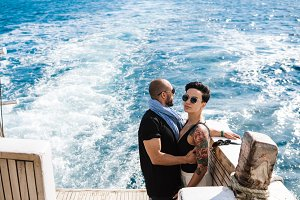 Couple relaxing on a yacht