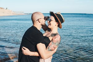 Couple in love embracing each other on beach