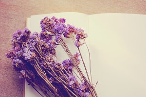 Blank notebook and flower
