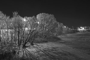 Shores of an icy river at night.