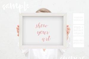 Girl Holding Frame Mockup + PSD
