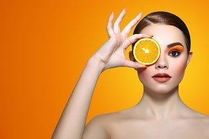 Girl and orange.