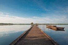 Wooden pier in a lake. Sunrise