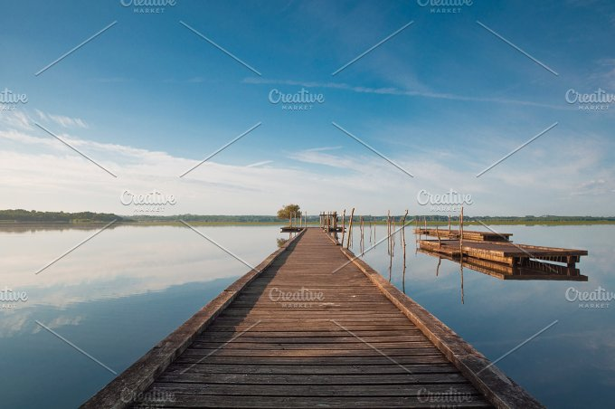 Wooden pier in a lake. Sunrise - Architecture