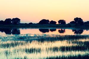 Sunset or sunrise reflection at lake