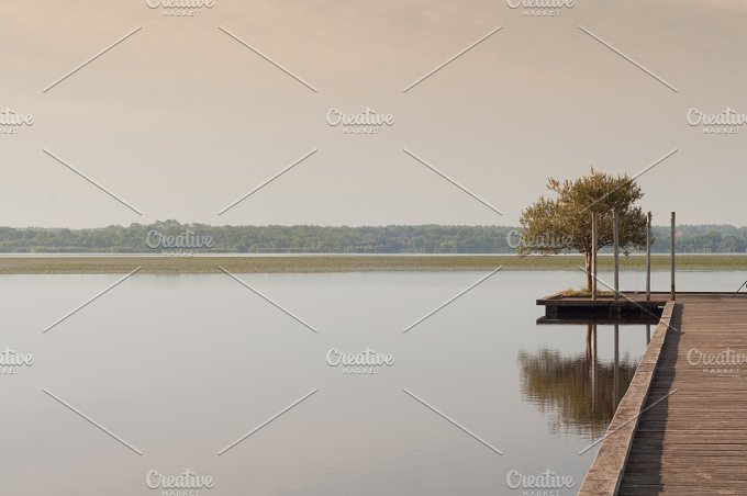 Wooden pier in a lake. Sunrise - Nature