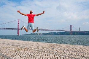 Young man jumping, Lisbon, Portugal
