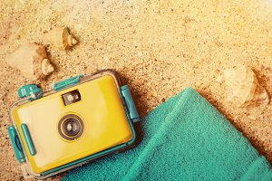 Summer accessories on sand background
