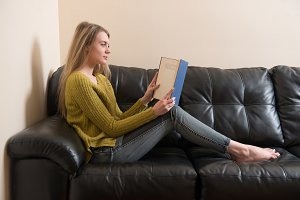 Woman reading a book and sitting
