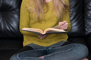 woman holding old book in hands