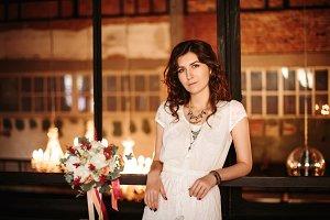 Tranquil bride posing in loft