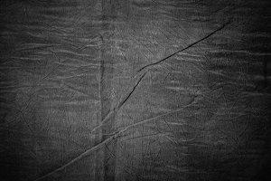 Texture of dark grey crumpled fabric