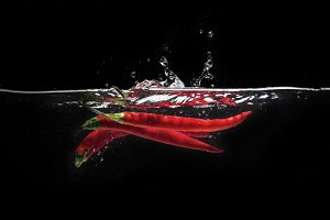 Red chili peppers in water