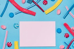 Blank pink paper with candies