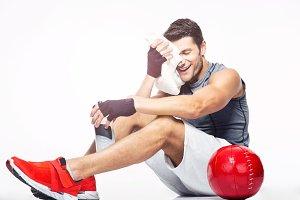 Fitness man resting on the floor