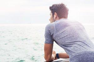 Sports man looking at sea outdoors