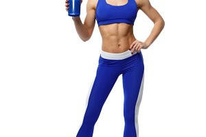 Athletic woman with a shaker on white background