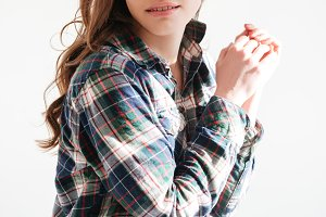 Portrait of beautiful young woman in plaid shirt